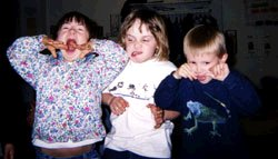 Quincy being silly with preschool friends, Charlie (center) and Brian in 2003