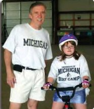 Dr. Dale Ulrich with a bicycle camp participant