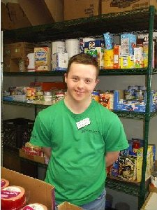Joe Kane, 19, who has Down syndrome, is a regular weekly volunteer at the center with his mother, Joan Kane.