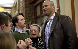 Cardinals first baseman Albert Pujols is greeted by Ethan Schroeder (left), of Eureka,, and Isabel Hogan (center) of St. Louis during an opening reception Wednesday evening for the Albert Pujols Wellness Center for Adults with Down Syndrome at St. Luke's Desloge Outpatient Center in Chesterfield. (Photo by Whitney Curtis/P-D)