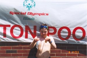 Joe Kane at ISU State Special Olympics: Gold Medal and Fourth Place Ribbon